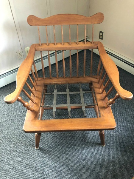 The wooden chair without a cushion.