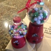 Mini Gumball Machine Christmas Ornament - two completed ornaments, one with pom poms and one with plastic beads
