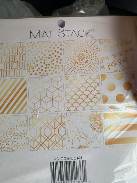 A package of decorative square paper.