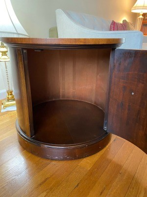 A round side table with a large cabinet.
