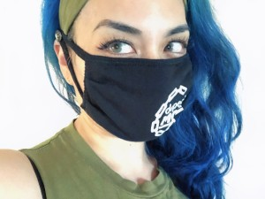 Buttoned Headband for Masks - woman wearing the headband with a mask attached around the buttons