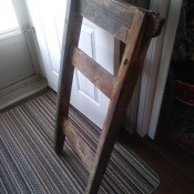 A wooden object inside, resembling a ladder or chair back.