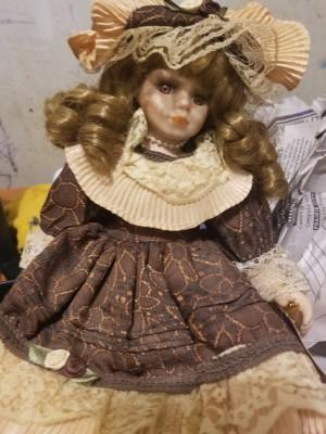 An ornate porcelain doll.