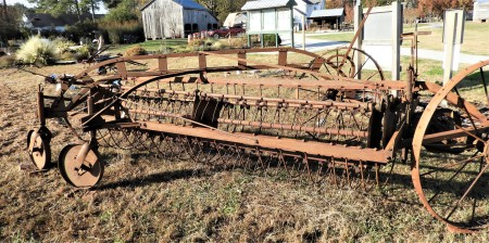 An old and rusted piece of farm equipment.