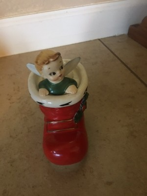 A figurine of a Christmas elf in a red boot.