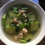A bowl of cucumber shrimp soup.
