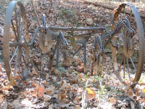 An old rusted piece of farm equipment.