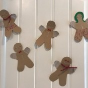 Colorful gingerbread people decorating a wall.