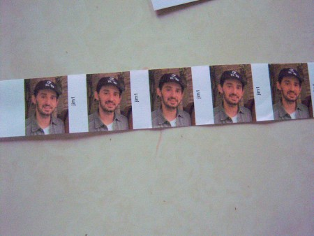 A strip of photos cut from a printed sheet.
