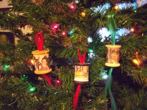 Spool ornaments hanging on the tree.