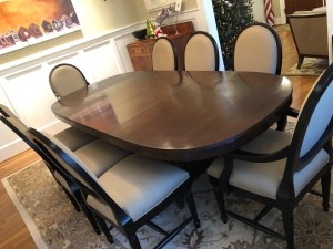A large mahogany dining table with 8 chairs.