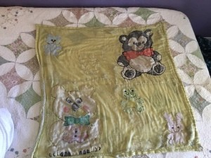 An old and worn baby blanket.