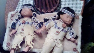 Two Native American porcelain dolls.
