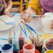 Painting a ceramic plate and vase.
