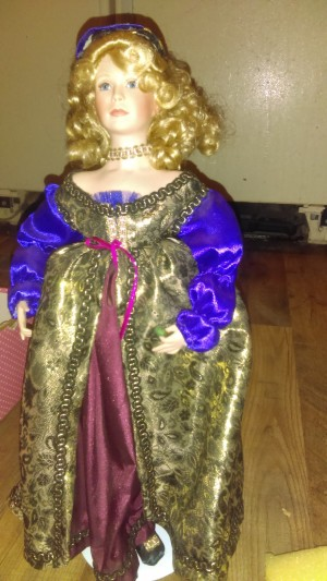 A princess doll in ornate clothing.