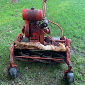 A vintage mower on a lawn.