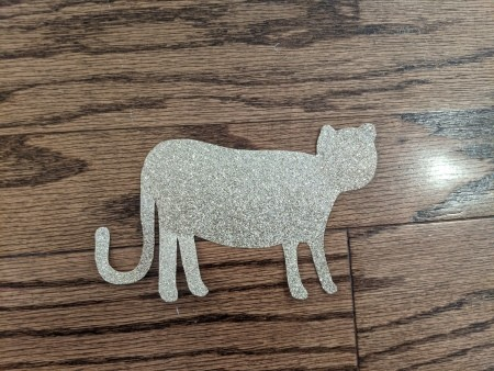 A cheetah shape cut out of glittery paper.