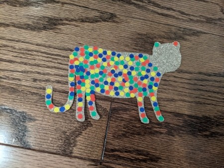 Decorating the cheetah with colorful spots.