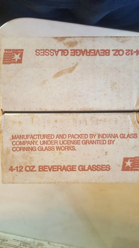 The markings on the back of a glass package.