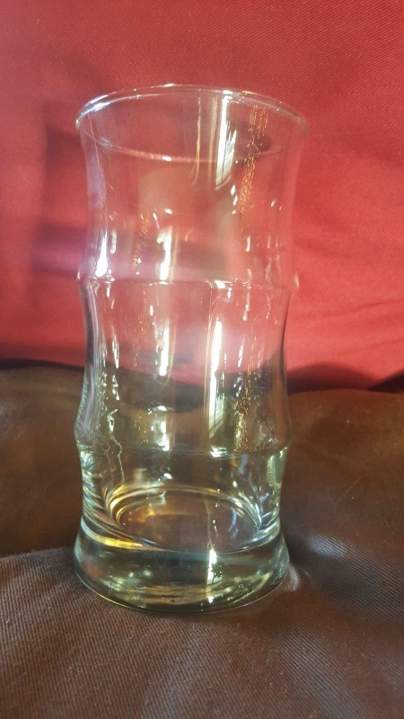 A small bamboo drinking glass.