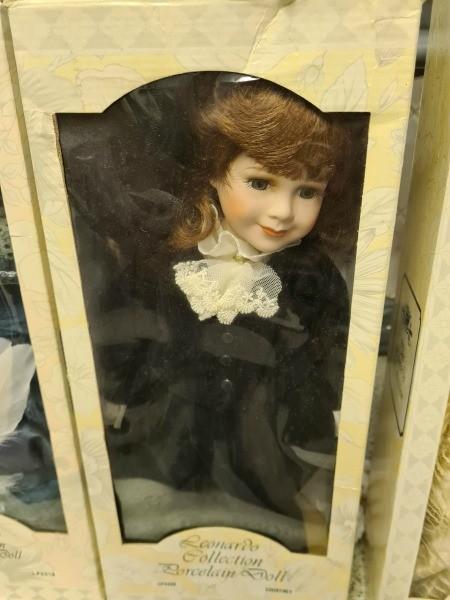 A porcelain doll in original packaging.