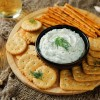 Cream cheese dip surrounded by crackers.
