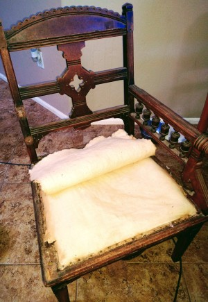 The back and seat of a vintage chair.