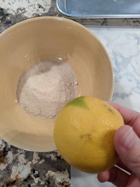 Adding lemon zest to the sugar.