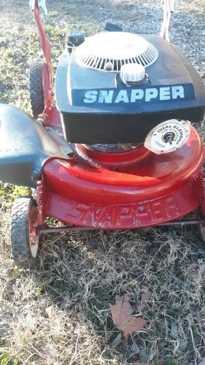 A vintage snapper push mower.