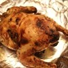 The Cornish game hen on a foil covered platter.