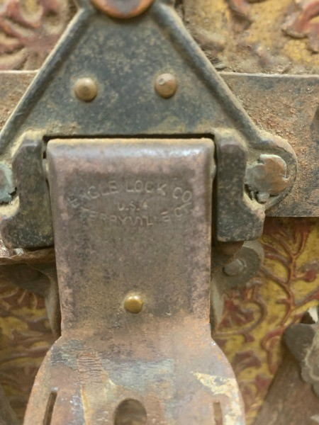 The metal lock on an old trunk.
