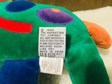 A label on a stuffed toy.