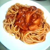 A plate of pasta and sauce.