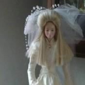 A porcelain bridal doll.