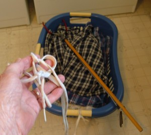 A clothes basket with strings attached for pulling.