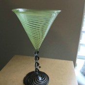 An ornate green cocktail glass.