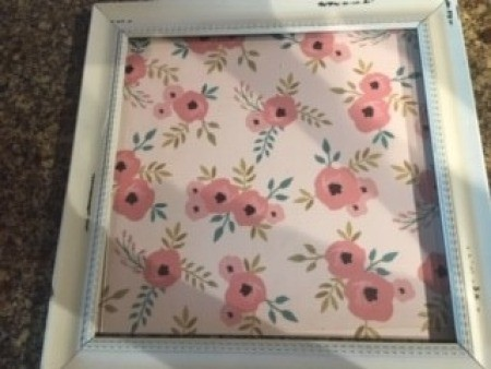 The frame filled with a piece of decorative paper.