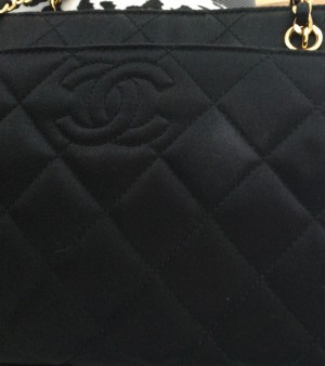 Removing a Spot on a Chanel Satin Purse? - whitish spot