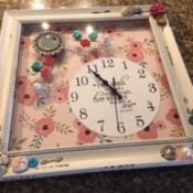 A decorative clock in a frame.