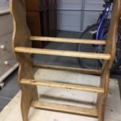 A completed wooden quilt rack.