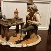 A figurine of a clock maker.