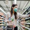 A woman shopping for non-perishable supplies.