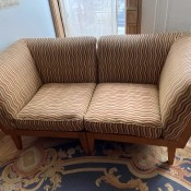 Two easy chairs that combine to a love seat.