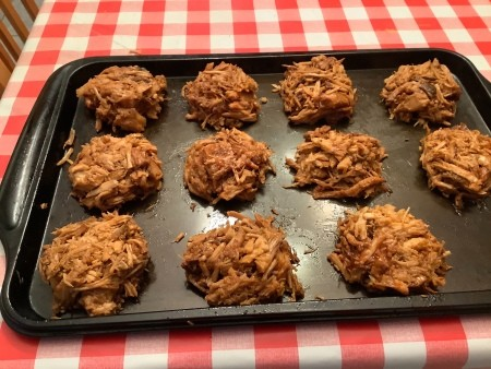 Individual serving of pulled pork on a cookie sheet.