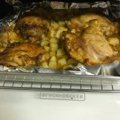 A sheet of roasted rosemary chicken with potatoes.