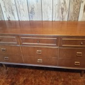 A long dresser with 9 drawers.