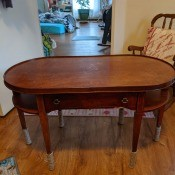 An oval wooden table.
