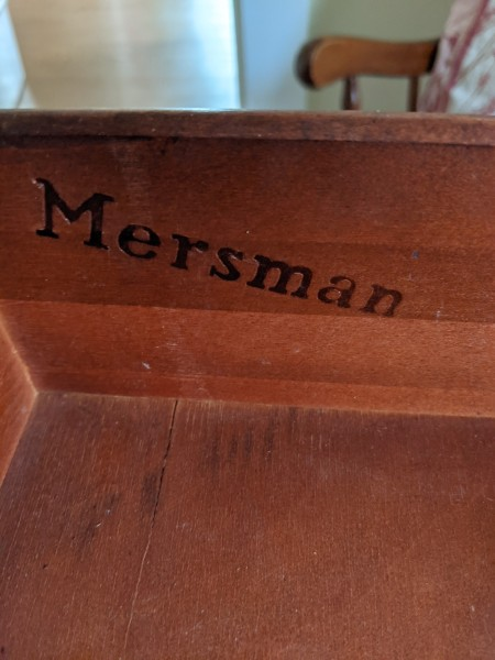 The Mersman marking on the underside of a table.