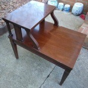 A Mersman side table with an upper shelf.