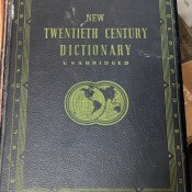 A hardbound dictionary with a black cover.
